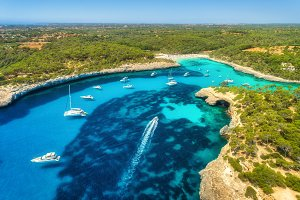 Aerial view of seashore with yachts