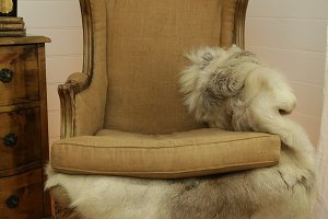 Old chair with fur blanket