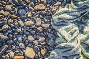 Beach towel on pebble