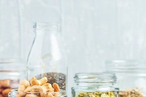Various nuts and seeds in glass jars