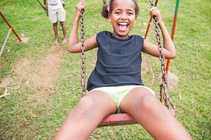 Ethiopian girl swinging in a swing