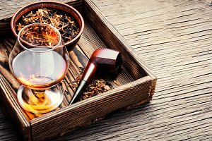 Cognac and pipe with tobacco