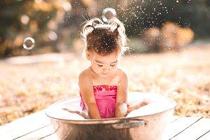 Baby washing outdoors