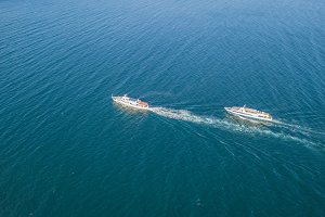 top view of two cruise ships in the
