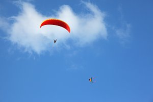 The red parachute flies in the blue