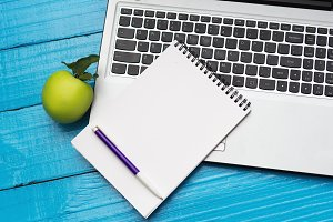 Notebook and blank notebook on blue