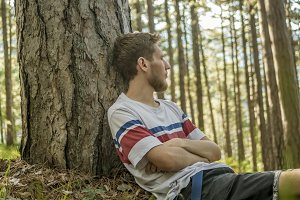 young male bearded hipster lying on