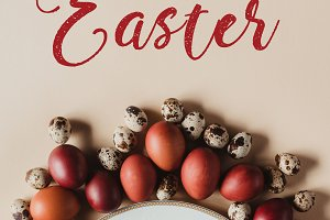top view of easter eggs around plate