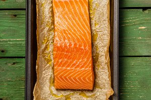 Baking dish with fresh raw salmon st