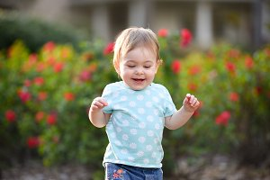 Cute toddler girl running