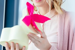 happy woman opening heart shaped gif