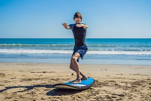 Young man surfer training before go