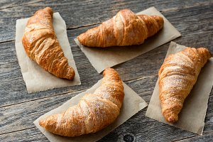 Freshly baked croissants on wood