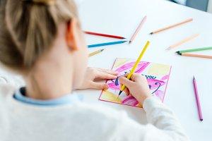 selective focus of kid drawing greet