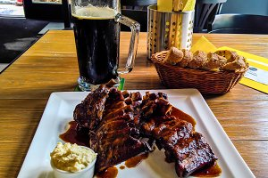 Mug of beer and plate of grilled por