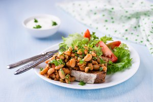 White beans in tomato sauce on toast