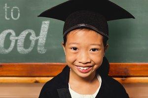 Smiling girl wearing mortarboard