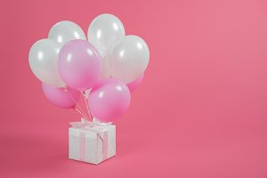 Gift box and balloons on pink backgr