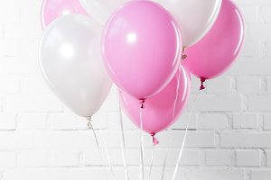 Bunch of pink and white balloons on