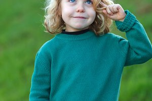 Small blond child with green jersey
