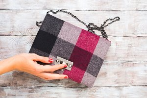 Woman's winter clutch on wooden tabl
