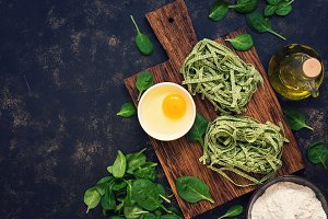 Noodle nests with spinach on dark fa