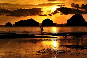 Couple walking on a sunset beach
