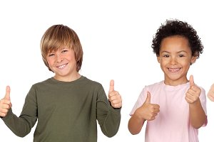 Happy children saying Ok with their