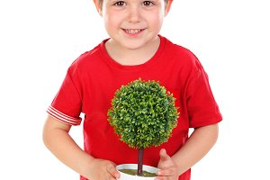 Happy kid with a beautiful plant for