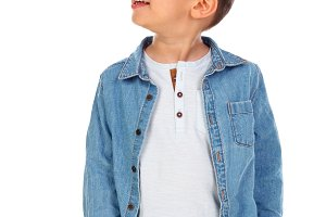 Pensive child with denim shirt looki