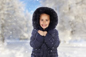 Sheltered girl with black coat in a