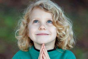 Beautiful child praying