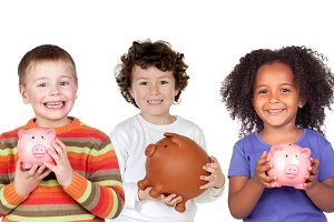 Three happy children with piggy-bank
