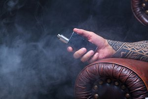 Hand close up. Vaper. The man with