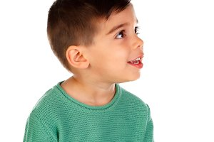 Pensive child with green t-shirt loo