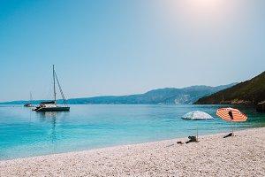 Idyllic white beach with umbrellas