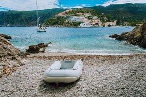 A dinghy on small hidden beach in