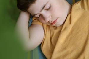 teenager boy sleeping while reading
