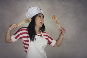 funny woman with wooden spoons