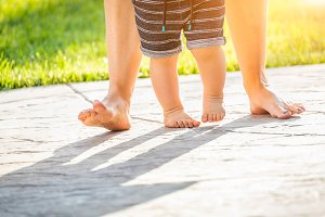 Mother and Baby Feet Taking Steps Ou