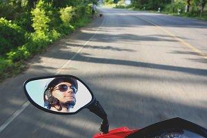 Motorbike rider's face in a mirror