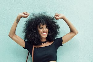 Funny black woman with afro hair rai