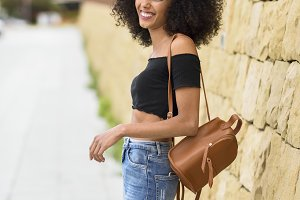 Smiling mixed woman with afro hair s