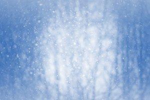 Winter blur background with snowflak