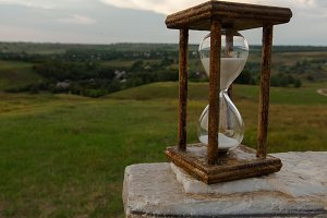 hourglass on stone marble background