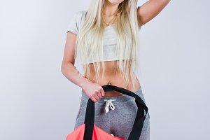 Blonde sport girl in studio