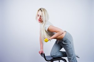 Blonde sport girl in studio
