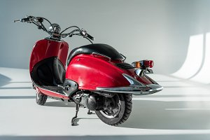 close up view of red vintage scooter