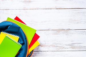 School backpack with stationery on