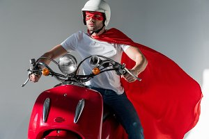 man in protective helmet and superhe